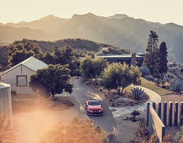 Lexus-LC against a scenic backdrop of mountains